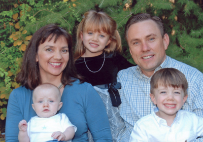 Pediatric dentist Dr. Sydney Moore and family